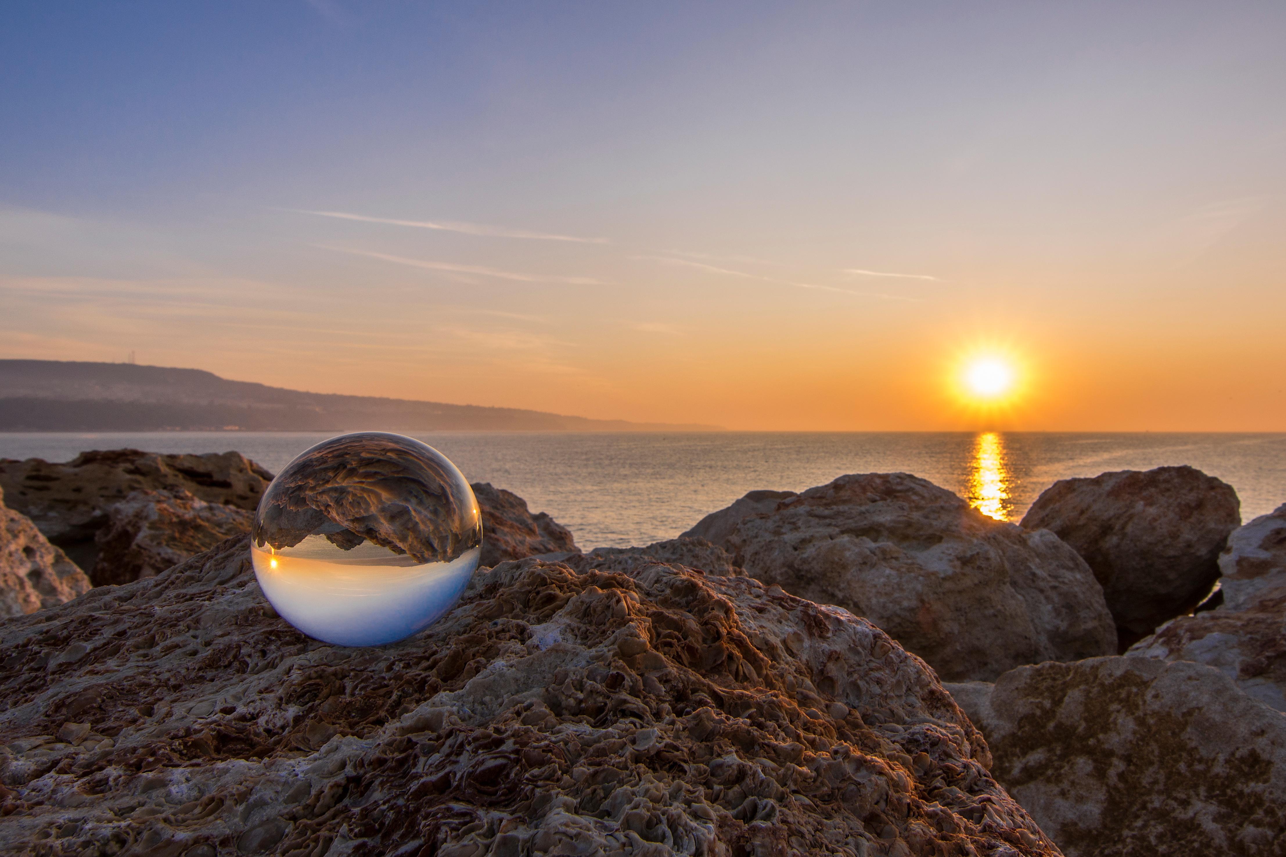 Sunrise-and-a-glass-ball-near-the-sea-854619484_4429x2952.jpeg