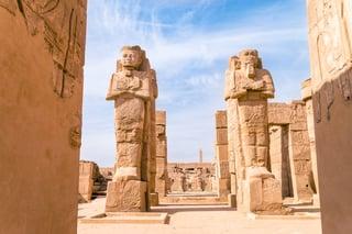 egyptian-statues-temple-ruins-ss_531850732.jpeg