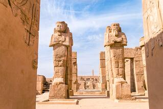 egyptian-statues-temple-ruins-ss_531850732.jpeg