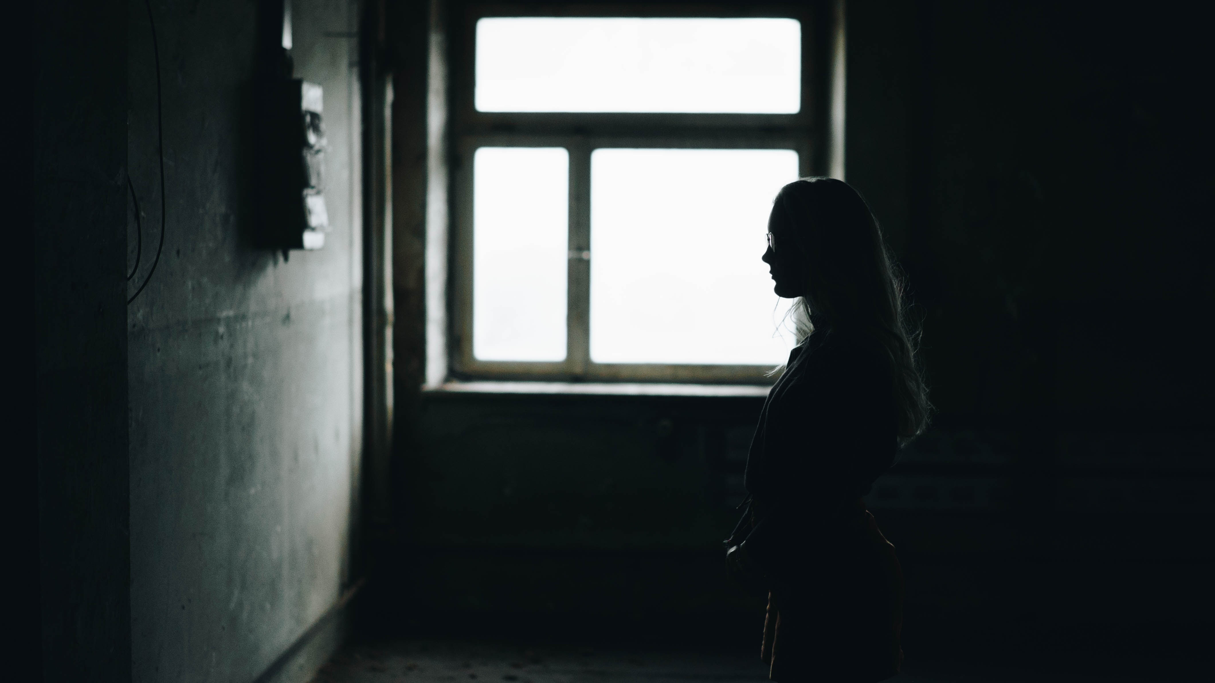 woman looking at wall